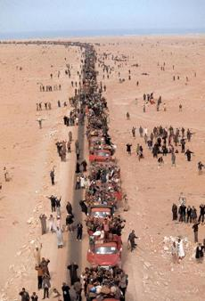 "Moroccans participating in ""The Green March"" in 1975, when the king of Morocco called on 300,000 civilians to stake Western Sahara as their own."